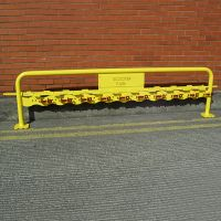 Double sided scooter rack with locking bar